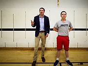 25 APRIL 2019 - DES MOINES, IOWA:  JROTC student HUNTER TROGDON, right, stands next to US Representative SETH MOULTON (D-MA), while Moulton talks to a JROTC class about public service, including military service, at Central Academy. Rep. Moulton visited Central Academy in Des Moines Thursday to talk to high school students and the school's JROTC class about public service. Moulton, a US Marine veteran who served in Iraq, is running to be the Democratic candidate for the US Presidency in 2020. Iowa traditionally hosts the the first selection event of the presidential election cycle. The Iowa Caucuses will be on Feb. 3, 2020.            PHOTO BY JACK KURTZ