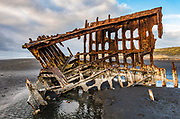 Shipwreck skeleton. In 1906, the crew of the sailing ship Peter Iredale took refuge at Fort Stevens, after she ran aground on Clatsop Spit. The wreck is visible today, within Fort Stevens State Park, along the Oregon Coast, USA. Active from 1863–1947, Fort Stevens was an American military installation that guarded the mouth of the Columbia River in the state of Oregon. Built near the end of the American Civil War, it was named for a slain Civil War general and former Washington Territory governor, Isaac I. Stevens.