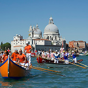 VENICE, ITALY - MAY 12:  A rowing boat sails in front of La Salute during the Sensa procession in Bacino Saint's Mark on May 12, 2013 in Venice, Italy. The festival of la Sensa is held in May on the Sunday after Ascension Day and follows a reenactment of the traditional ceremony where the Doge enacted the wedding of Venice to the sea.  (Photo by Marco Secchi/Getty Images)