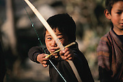 The most esteemed sport in Bhutan is archery and is practiced by young and old. Nalim and Namgay's grandson Chato Geltshin practices the Bhutanese national pastime in his village of Shingkhey, Bhutan From coverage of revisit to Material World Project family in Bhutan, 2001.