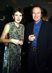 LADY CHARLOTTE FRASER and writer WILLIAM BOYD, at a party in London on 29th November 1999.MZN 67