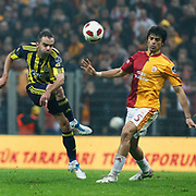 Galatasaray's Gokhan ZAN (R) and Fenerbahce's Semih SENTURK (L) during their Turkish superleague soccer derby match Galatasaray between Fenerbahce at the Turk Telekom Arena in Istanbul Turkey on Friday, 18 March 2011. Photo by TURKPIX