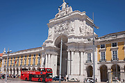 A double-decked bus with Lisbon Sightseeing company, passes the architecture of Arco Da Rua Augusto Arch in Praca do commercio, on 12th July 2016, in Lisbon, Portugal. These buses give tourists a fine view of many European cities. The Rua Augusta Arch is a stone, triumphal arch-like, historical building and visitor attraction in Lisbon, Portugal, built to commemorate the citys reconstruction after the 1755 earthquake. It has six columns some 11 m high and is adorned with statues of various historical figures.