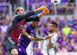April 8, 2018 - Orlando, FL, U.S. - ORLANDO, FL - APRIL 08: Portland Timbers goalkeeper Jake Gleeson (90) punches the ball away from Orlando City forward Dom Dwyer (14) during the MLS soccer match between the Orlando City FC and the Portland Timbers at Orlando City SC on April 8, 2018 at Orlando City Stadium in Orlando, FL. (Photo by Andrew Bershaw/Icon Sportswire) (Credit Image: © Andrew Bershaw/Icon SMI via ZUMA Press)