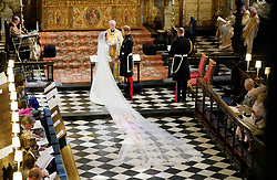 Prince Harry and Meghan Markle exchange vows in St George's Chapel at Windsor Castle during their wedding service, conducted by the Archbishop of Canterbury Justin Welby.