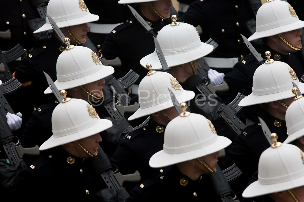 The white helmets of the Royal Marines who march through the City of London during the annual Lord Mayor's Show. The new Mayor's procession consists of a 3-mile, 150-float parade of commercial and military organisations going back to medieval times. This is the oldest and longest civic procession in the world that has survived the Plague and the Blitz, today one of the best-loved pageants. Henry Fitz-Ailwyn was the first Lord Mayor (1189-1212) and ever since, eminent city fathers (and one woman) have taken the role of the sovereign's representative in the City – London's ancient, self-governing financial district. The role ensured the King had an ally within the prosperous enclave.