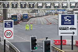 © Licensed to London News Pictures 26/12/2020.        Dover, UK. Police at the Port of Dover. Over 1000 lorries are left queuing on the M20 heading for Dover as Manston Airport is cleared. Emergency services and military personnel continue to tests travellers at Dover in Kent for Coronavirus before they cross the English Channel. Photo credit:Grant Falvey/LNP