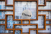 A detail of the closed sign that hangs in the door of a Chinese restaurant in Holborn during the Coronavirus pandemic, at a time when only some retailers and business are re-opening while office workers still largely work from home, on 2nd September 2020, in London, England.