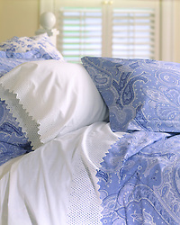 bed with blue paisley sheets