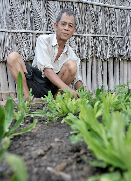 Men Sia maintains a small garden beside his home in Soepreng, a village in the Kampot region of Cambodia.