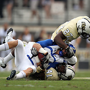 Memphis wide receiver Tannar Rehrer (85) gets tackled by Central Florida linebacker Jonathan Davis (27) and Central Florida linebacker Terrance Plummer (41) during an NCAA football game between the Memphis Tigers and the Central Florida Knights at Bright House Networks Stadium on Saturday, October 29, 2011 in Orlando, Florida. (AP Photo/Alex Menendez)