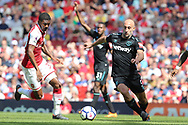 Arsenal midfielder Ainsley Maitland-Niles (30) & West Ham United defender Pablo Zabaleta (5) during the Premier League match between Arsenal and West Ham United at the Emirates Stadium, London, England on 22 April 2018. Picture by Bennett Dean.