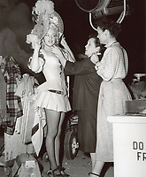 "1949 Wardrobe stylists dress Marilyn Monroe  for her role as Clara in ""A Ticket To Tomahawk"" at Fox Studios"