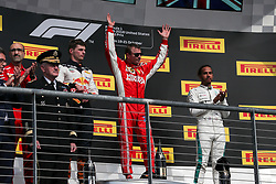 October 21, 2018 - Austin, TX, U.S. - AUSTIN, TX - OCTOBER 21: Ferrari driver Kimi Raikkonen (7) of Finland celebrates victory on podium with Red Bull Racing driver Max Verstappen (33) of Netherlands and Mercedes driver Lewis Hamilton (44) of Great Britain after the F1 United States Grand Prix on October 21, 2018, at Circuit of the Americas in Austin, TX. (Photo by John Crouch/Icon Sportswire) (Credit Image: © John Crouch/Icon SMI via ZUMA Press)