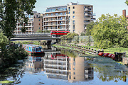 London Red bus reflects in the River Lea as it drives over the Lea Bridge in east London on Friday, Aug 7, 2020.<br /> The UK has seen its hottest day in August for 17 years, as temperatures reached more than 36C (96.8F) in south-east England, British press reports. Crowds of people headed to the coasts and rivers to enjoy the weather, but people have been urged to adhere to social distancing. (VXP Photo/ Vudi Xhymshiti)