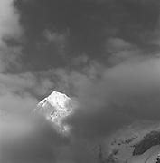 Bluemlisalp Peaks Through The Clouds