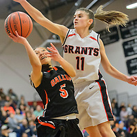 101615  Adron Gardner/Independent<br /> <br /> Gallup Bengal Kalisha Kinsel (5) attempts a shot under leaping Grants Pirate Caroline Bachman (11) at Grants High School Friday