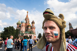 July 13, 2018 - Moscow, Russia - 180713 A fan of Russia in front of The Saint Basil's Cathedral at the Red Square during the FIFA World Cup on July 13, 2018 in Moscow..Photo: Petter Arvidson / BILDBYRN / kod PA / 92086 (Credit Image: © Petter Arvidson/Bildbyran via ZUMA Press)