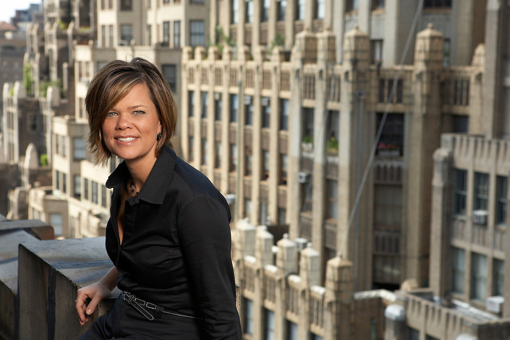 Woman executive poses for portrait on NYC rooftop