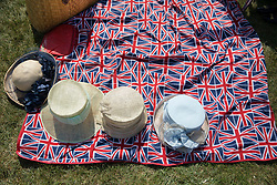 © Licensed to London News Pictures. 10/05/2017. Windsor, UK. Ladies hats are placed on a Union flag decorated picnic blanket at the Royal Windsor Horse Show. The five day equestrian event takes place in the grounds of Windsor Castle. Photo credit: Peter Macdiarmid/LNP