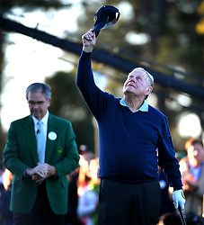 With tears in his eyes, Jack Nicklaus, right, looks to heaven and raises his hat in honor of Arnold Palmer as he performs a ceremonial opening tee shot to begin The Masters tournament at Augusta National Golf Club on Thursday, April 6, 2016 in Augusta, Ga. (Photo by Jeff Siner/Charlotte Observer/TNS)  *** Please Use Credit from Credit Field ***