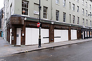 Scene in Soho with Cafe Boheme closed down and boarded up as the national coronavirus lockdown three continues on 29th January 2021 in London, United Kingdom. Following the surge in cases over the Winter including a new UK variant of Covid-19, this nationwide lockdown advises all citizens to follow the message to stay at home, protect the NHS and save lives.