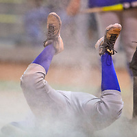 Catcher Krystal Billy slides into home base while attempting to score during a softball championship at Ford Canyon Park in Gallup.