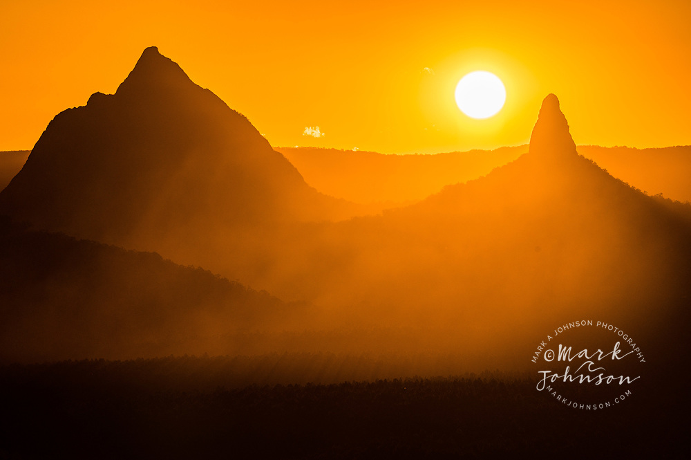Sunset behind Mt Beerwah (left) & Mt Coonowrin (r), Glass House Mountains from Wild Horse Mountain lookout, Sunshine Coast Hinterland, Queensland, Australia