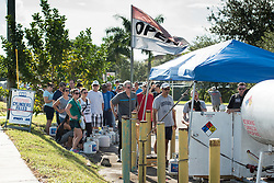 September 6, 2017 - Davie, Florida, U.S - Florida residents line up to get their propane cylinders filled in preparation for hurricane Irma, in Davie, Fla. Florida Governor, Rick Scott, declared a state of emergency for all counties in Florida on Monday, in anticipation of possible impact of category five Hurricane Irma later this week. (Credit Image: © Orit Ben-Ezzer via ZUMA Wire)