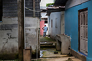 Respite from the rain in the backstreets of Boca de Sabalo, Darien Province, Panama.