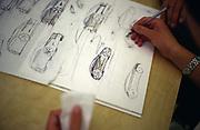 A designer works on the plans of a new Jaguar car. Jaguar design studios, Coventry, UK