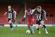 Grimsby Town Luke Hendrie (2) Scunthorpe United Abo Eisa (11) battles for possession during the EFL Sky Bet League 2 match between Grimsby Town FC and Scunthorpe United at Blundell Park, Grimsby, United Kingdom on 19 December 2020.