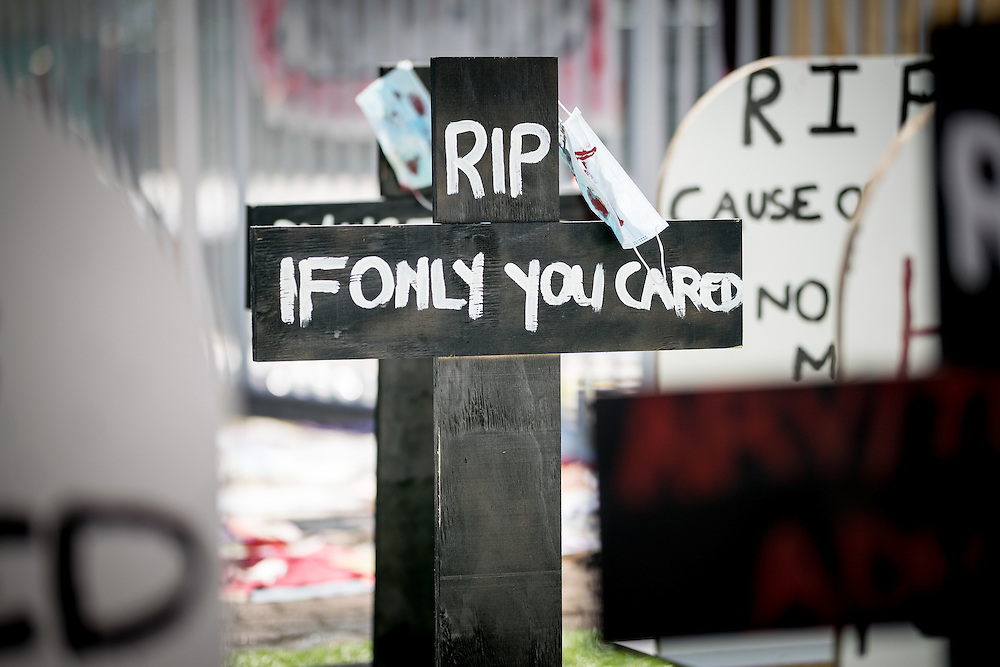 Tombstones and crosses at a demonstration site for the rights to better working conditions for health workers.