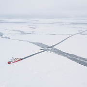 The icebreaker cuts a path in the newly forming ice of the Arctic Ocean.