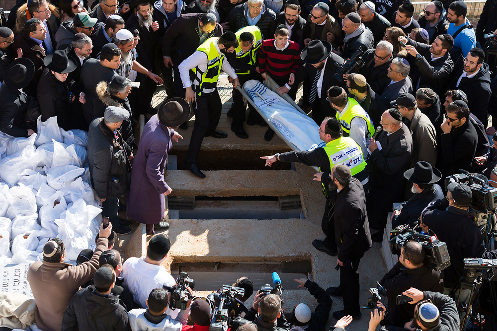 Israeli and French friends, and relatives, carry the body of Francois-Michel Saada during the joint funeral of four Jewish victims of the terrorist attack on a kosher grocery store in Paris last week, at Givat Shaul cemetery in Jerusalem, Israel, on January 13, 2015. Thousands of mourners attended the funeral of Yohan Cohen, Philippe Braham, Francois-Michel Saada and Yoav Hattab, the four French Jews killed in the attack, after their bodies of were flown to Israel from France for burial in the Jewish state.