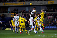Ivan Toney of Peterborough United jumps above the rest during the EFL Sky Bet League 1 match between Oxford United and Peterborough United at the Kassam Stadium, Oxford, England on 16 February 2019.