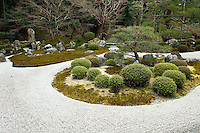 """Manshu-in also known as Manshuin Monzeki is a Tendai sect Zen Buddhist temple located near the Shugakuin Imperial Villa in Kyoto.  The temple's major garden is in the Karesansui style, and now designated as an eminent scenery; it contains a notable Pinus pentaphylla tree, now about 400 years old, set within an """"island"""" on a stream of white sand.  This garden lies just south of Shugakuin Detached Palace on the grounds of the Monzekiji-in temple (a Tendai sect temple). Prince Toshihito's (who designed Katsura) second son, Yoshihisa seems to have had some connection with this garden's construction in 1656. The original buildings still stands in their original locations, and their Shoin style closely resembles that of Katsura. The garden is wrapped around both the large and small shoin, but according to Gunter Nitsche, it is best viewed from the small shoin. Its design is that of a pond garden in terms of layout, but the older Heian form has been transformed into the dry karesansui of the Edo period. An artificial Mount Horai is paired with rock groupings on its left. A stone bridge """"Ishibashii"""" crosses a dry stream and a second bridge of stone slabs links a penninsula to a crane island in the far west. On the crane island are three undulating rock groups that resemble the nosuji of the Heian period . In front is a turtle island floating in an expanse of white gravel."""