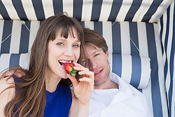 Couple eating strawberry