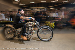 """Ryan Grossman on his 1948 HD Panhead known as Dean """"The Dean"""" Lanza's Quicksilver dual-carbed Panhead """"Show Dragster"""" for the Grand Entry into the Mooneyes Yokohama Hot Rod & Custom Show. Yokohama, Japan. December 6, 2015.  Photography ©2015 Michael Lichter."""