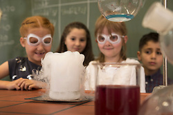 Elementary students doing experiment with reeky liquid in chemistry class, Fürstenfeldbruck, Bavaria, Germany