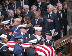 Dignitaries pay their respects as the casket containing the remains of the late former United States President George H.W. Bush at the National funeral service in his honor at the Washington National Cathedral in Washington, DC on Wednesday, December 5, 2018. Front row: United States President Donald J. Trump, first lady Melania Trump, former US President Barack Obama, former US President Bill Clinton, former US Secretary of State Hillary Rodham Clinton, former US President Jimmy Carter and former first lady Rosalynn Carter. Second row: former US Vice President Dan Quayle, Marilyn Quayle, former US Vice President Dick Cheney, Lynne Cheney. Photo by Ron Sachs / CNP/ABACAPRESS.COM
