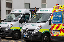 © Licensed to London News Pictures. 06/10/2020. Surrey, UK. Ambulance crews give a thumbs up as they wait outside St Helier Hospital A&E today. St Helier Hospital in Sutton, Surrey has been put in partial lockdown after a Covid outbreak where up to 6 patients have contracted the disease. Visits have been restricted and ambulances have been diverted to other hospital A&Es. Photo credit: Alex Lentati/LNP