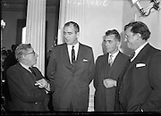 TV Press Conference held by Mr E Roth, Director of Radio Telefis Eireann. Donagh MacDonagh (left)<br /> 07/04/1961