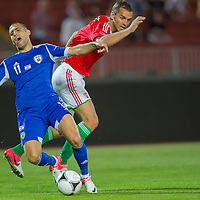 Israel's Eitey Menachem Shechter (L) falls as he fights for the ball during a friendly football match Hungary playing against Israel in Budapest, Hungary on August 15, 2012. ATTILA VOLGYI