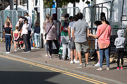 © Licensed to London News Pictures. 17/09/2020. London, UK.  Queues of people outside a walk-in Covid-19 testing centre Edmonton, North London. The UK government is considering rationing Coronavirus tests for the general public has seen an increased demand for Covid-19 tests  in recent days and a rise of over 3,500 daily. Photo credit: London News Pictures