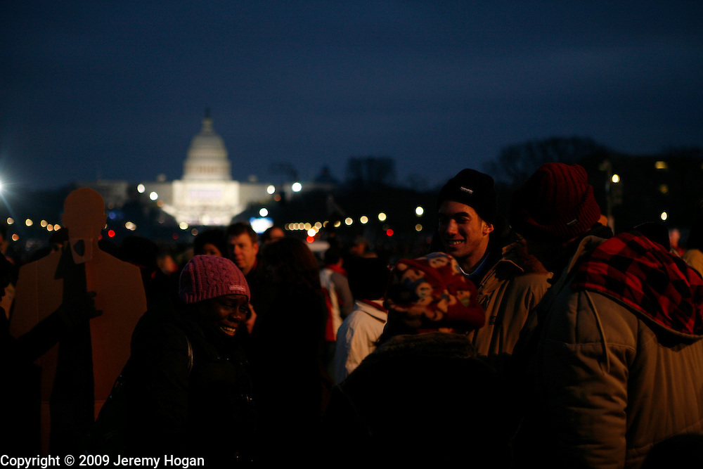 Barack Obama supporters gather on the National Mall on the evening before Obama's inauguration ceremony at the Capitol Building.