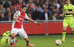 17-09-2015 NED: UEFA Europa League AFC Ajax - Celtic FC, Amsterdam<br /> Ajax heeft in zijn eerste duel in de Europa League thuis moeizaam met 2-2 gelijkgespeeld tegen Celtic / Anwar El Ghazi #21 wordt onderuit gehaald waardoor Emilio Izaguirre #3 rood krijgt