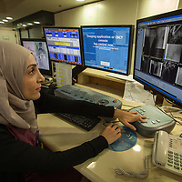 Hiba Houshieh, technician at the Cancer Treatment Centre of the Augusta Victoria Hospital, directs a radiotherapy session from her control panel. The Augusta Victoria Hospital is located on the southern side of Mount of Olives in East Jerusalem and is run by the Lutheran World Federation, LWF.