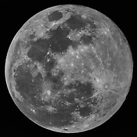 """Full Moon from a balcony a the Vinoy Hotel in St. Petersburg, Florida. Image taken with a Nikon D300 camera and Questar 3.5"""" telescope (ISO 3200, ~1400 mm, f/16, 1/4000 sec)."""