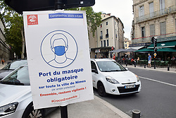 Obligatory to wear a mask in town centres during Covid pandemic, Nimes, Southern France 2021